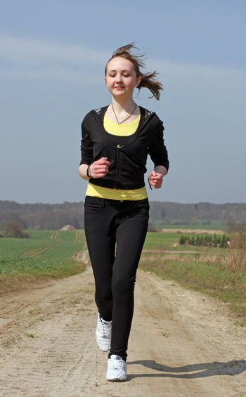young running girl on black