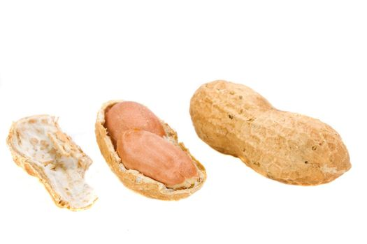 some natural peanuts on white background