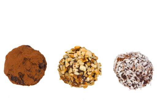 closeup of three home made chocolate pralines isolated on white background