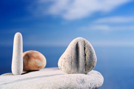 Pebble against the blue sky