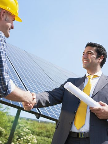 businessman and electrician shaking hands