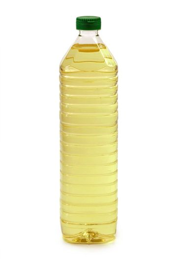 Cooking oil in a plastic bottle - isolated on white background