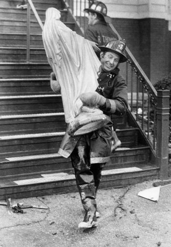 A firefighter carries a statue of Mother Mary out of the St. Patrick's Church in Stoneham, MA after a fire was put out in the Church. This picture was taken in 1977.
