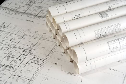 Engineering and architecture drawings laid on a table