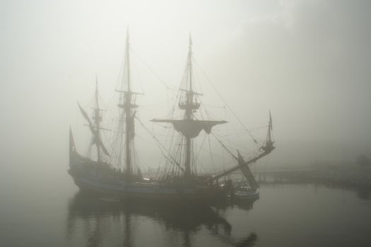 Old sail ship (Pirate?) in the fog early morning