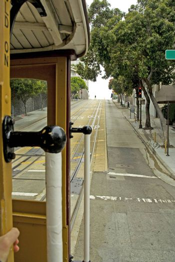 Famous cable car in San Francisco in motion, view from inside