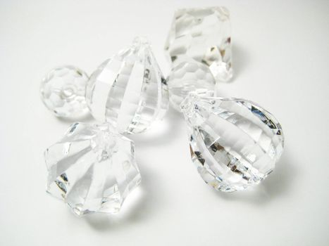 A few crystals on a white background.
