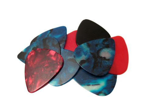 A few assorted guitar picks isolated on a white background.