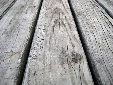 A wooden surface of a picnic table
