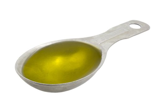 Measuring tablespoon of olive oil isolated on white, clipping paths included