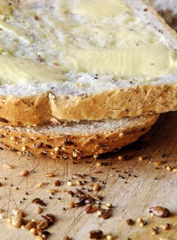 slices of fresh seeded bread, spread with butter