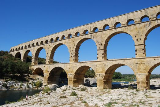 Aqueduct, Pont du Gard, Nimes, the aqueduct is 49 m high and was build by the romans, Marcus Vipsanius Agrippa, around the year 19 BC. Listed on the UNESCO's list of World Heritage.
