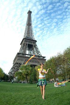 acrobat infront of eiffel tower