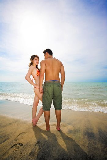 romantic young couple by the beach