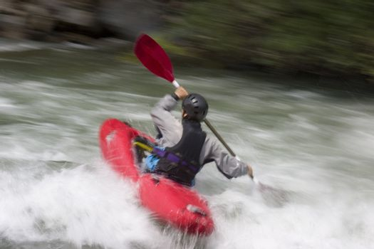 Kayak on a whitewater river. With tripod and long exposure time - motion blurred