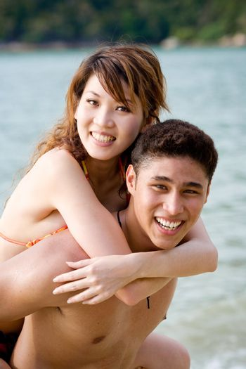 happy young couple having fun on the tropical beach