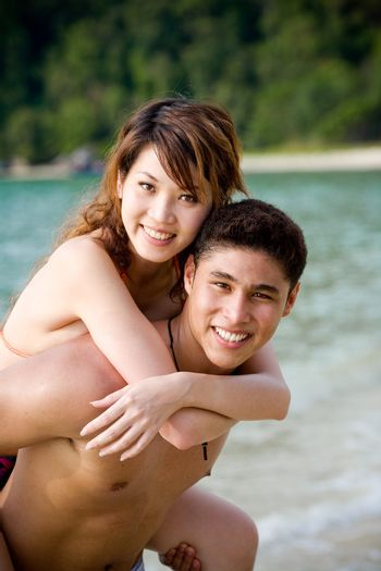 happy young couple by the beach