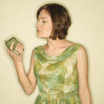 Woman with handheld radio.