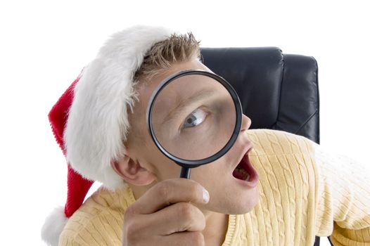 man wearing santa hat and looking through lens on an isolated background