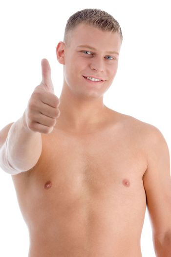 smiling muscular man showing approval sign on an isolated background
