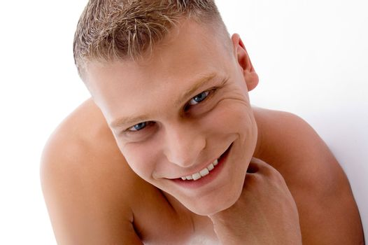 close up of smiling muscular man with white background