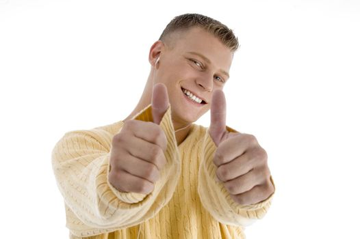 handsome man showing good luck sign with both hands on an isolated white background