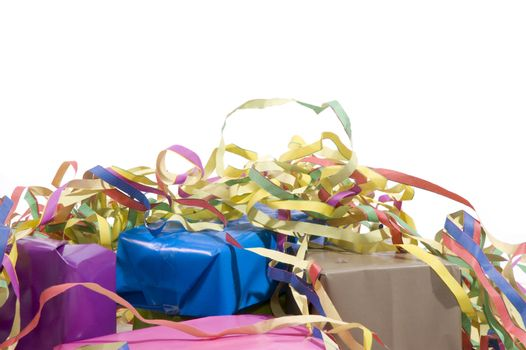 presents wrapped in paper with colorful streamers
