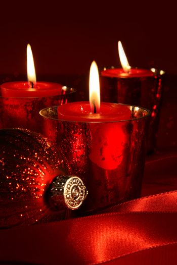 Red candles with ribbons