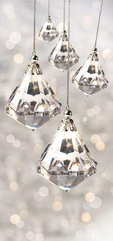 Crystal christmas ornaments against silver
