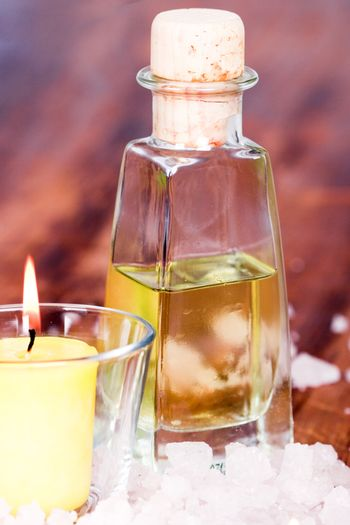 bath and spa items (oil, salt, candle) on wooden background