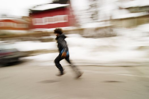 A motion blur abstract of a person walking in a hurry, a late or panic rushing concept image.