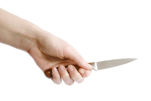 A small pearing knife in a female hand, ready to cut something.  Isolated on white with clipping path.