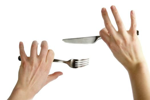 Two awkward womans hands holding a knife and fork. Isolated on white.