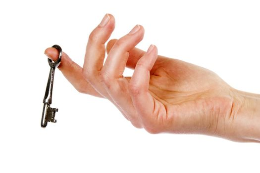 A concept image of a womans hand holding a key, dangling on one finger. Isolated on white with clipping mask.