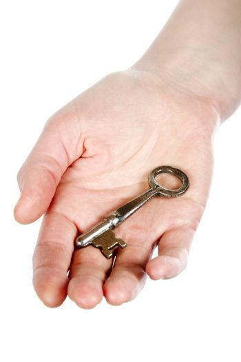 A concept image of a womans hand holding a key on an open palm. Isolated on white with clipping mask.