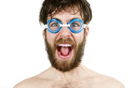 A humorous image of a young bearded male wearing swimming goggles, yelling.