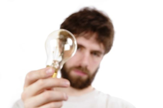 A concept image displaying a very out of focus man and light bulb, conveying a fuzzy, or unclear idea.