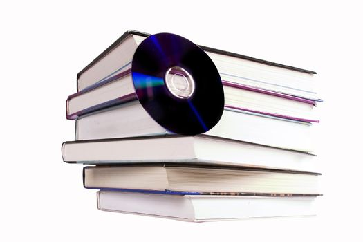 A stack of books with a cd.  A concept image for digital books