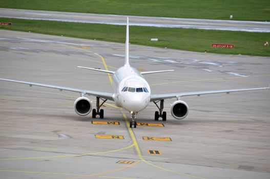 Airplane taxiing at large airport