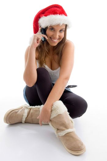 female wearing christmas hat and talking on mobile