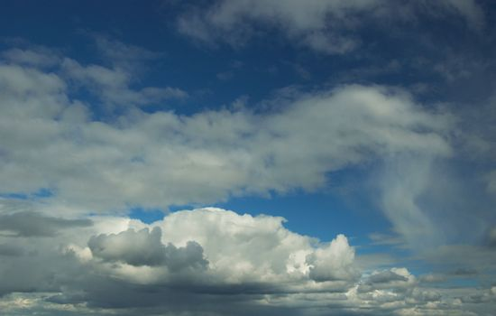 In the blue sky translucent stratose and cumulus clouds