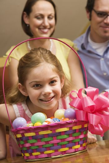 Caucasian family with girl and Easter basket.
