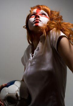 english football makeup girl holding worn soccer ball