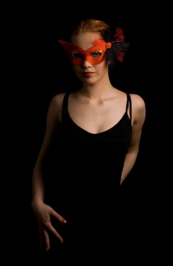 mysterious lady in red mask ready to dance
