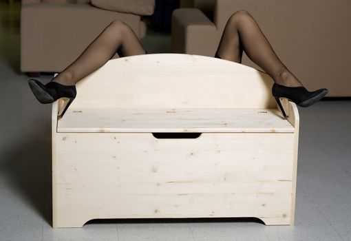 woman legs over wooden box