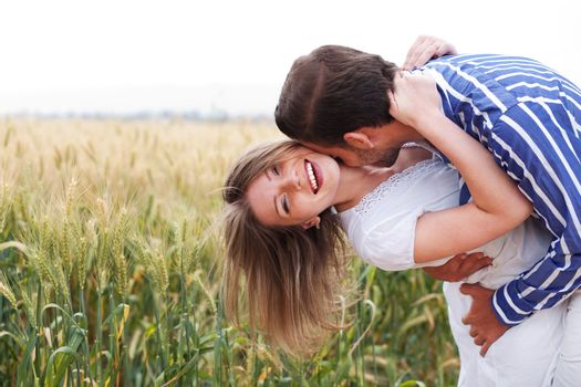 Happy young Couple hugging and kissing eachother, outdoor