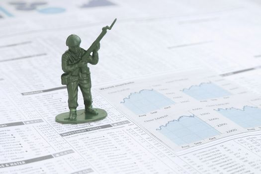 Small Toy solder on a News paper Stock market financial page sho