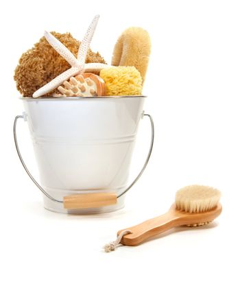 White bucket filled with sponges and scrub brushes