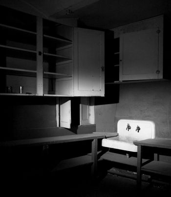 Old Sink and Cabinets Inside a Condemned Building
