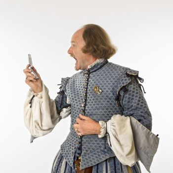 Shakespeare screaming at cell phone.